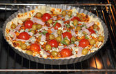 Pizza inserted into the oven — Stock Photo