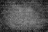 Old dark brick wall — Stock Photo