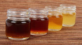 Honey in glass jars — Stock Photo