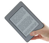 Holding E-book reader in hands — Stock Photo