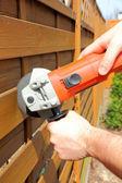 Man cutting fence — Stock Photo