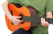 Teenager with acoustic guitar — Stock Photo