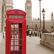Stock Photo: Traditional red phone booth in London with Big Ben in sepibackground