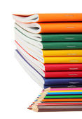Exercise books and pencils — Stockfoto