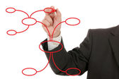 Businessman drawing a mind map — Stock Photo