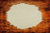Grungy paper background surrounded by brick frame — Stock Photo