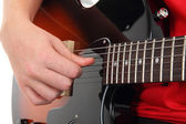 Electric guitar with hands, Musical instrument with teen's hands — Stock Photo