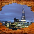Night city through brick frame. Urban abstract concept.  — Stock Photo