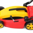 Stock Photo: New lawn mower. Isolated over white background