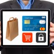 Businessman presenting  safe shopping in a digital tablet — Stock Photo