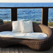 A modern wicker garden sofa — Stock Photo