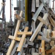 Stockfoto: Lot of different crosses most of wood tied to support as memorial.