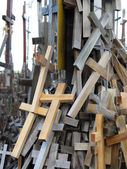 A lot of different crosses most of wood tied to support as memorial. — Stock Photo