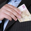 Business man hiding money in pocket. — Stock Photo