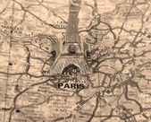 Retro Eiffel Tower on a map of Paris — Стоковое фото