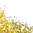 Golden stars in the form of confetti on white — Stock Photo #50982159