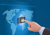 Businessman selecting a padlock with world map on the background — Stock Photo