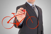 Man's Hand draws a bicycle — Stock Photo