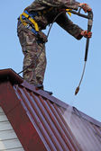 Worker on top of roof — Stock Photo