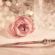 Elegant and romantic dinner setting with rose decoration and lights — Stock Photo #32169279