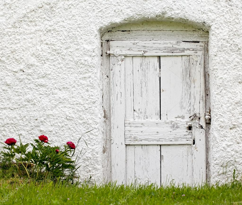 Old white wood door with gardening flowers stock photo for White wooden front doors