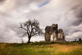 Church ruin with old tree and clouds — Stock Photo