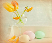 Colorful eggs with tulips for Easter — Stock Photo