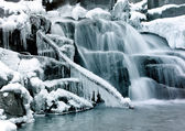 Little cascade with ice and icicles — Stock Photo