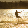Stock Photo: Wake- boarding on the lake with silhouette