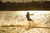 Wake- boarding on the lake with silhouette — Stock Photo