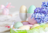Eggs decoration with lance and purple flowers — Stock Photo
