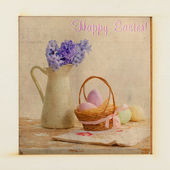 Basket and colorful Easter eggs and flowers — Stock Photo