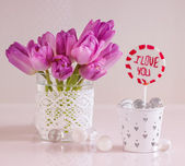 Tulips and lollipop with I love you inscription — Photo