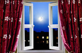 Open window to London buildings at night — Stock Photo