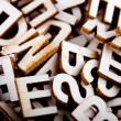Jumbled wooden letters close up — Stock Photo #13556132