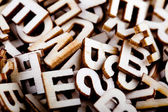 Jumbled wooden letters close up — Stock Photo