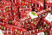 All red Christmas presents with tags — Stock Photo