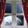 View of the Earth through a window with curtains — Stockfoto