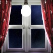 Light bulb shining in window — Foto Stock