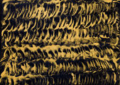 Golden coils painting in wax — Stock Photo