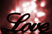 Love sign with red sparkle — Stock Photo