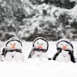 Little snowmen in a group — Stock Photo #19719417