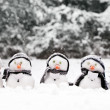 Stock Photo: Little snowmen in group