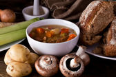 Home made soup and bread — Stock Photo