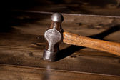 Hammer on a wooden floor — Stock Photo