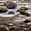 Stock Photo: River flowing over rocks