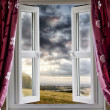 Open window onto landscape view - Stock Photo