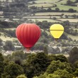 Two hot air baloons drifting — ストック写真