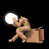 Light bulb box man character — Stock Photo