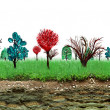 Painted trees and earth cross section — Stock Photo